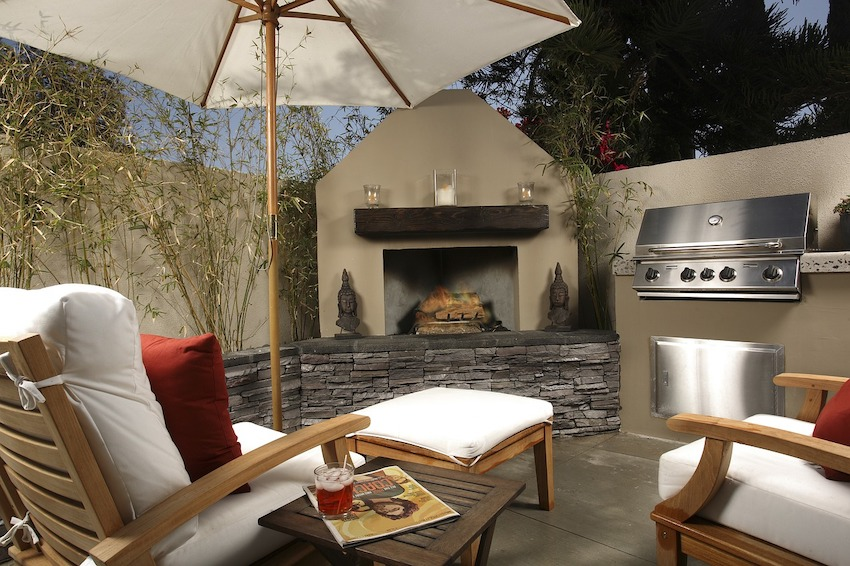 luxurious backyard with fire pit and seating area