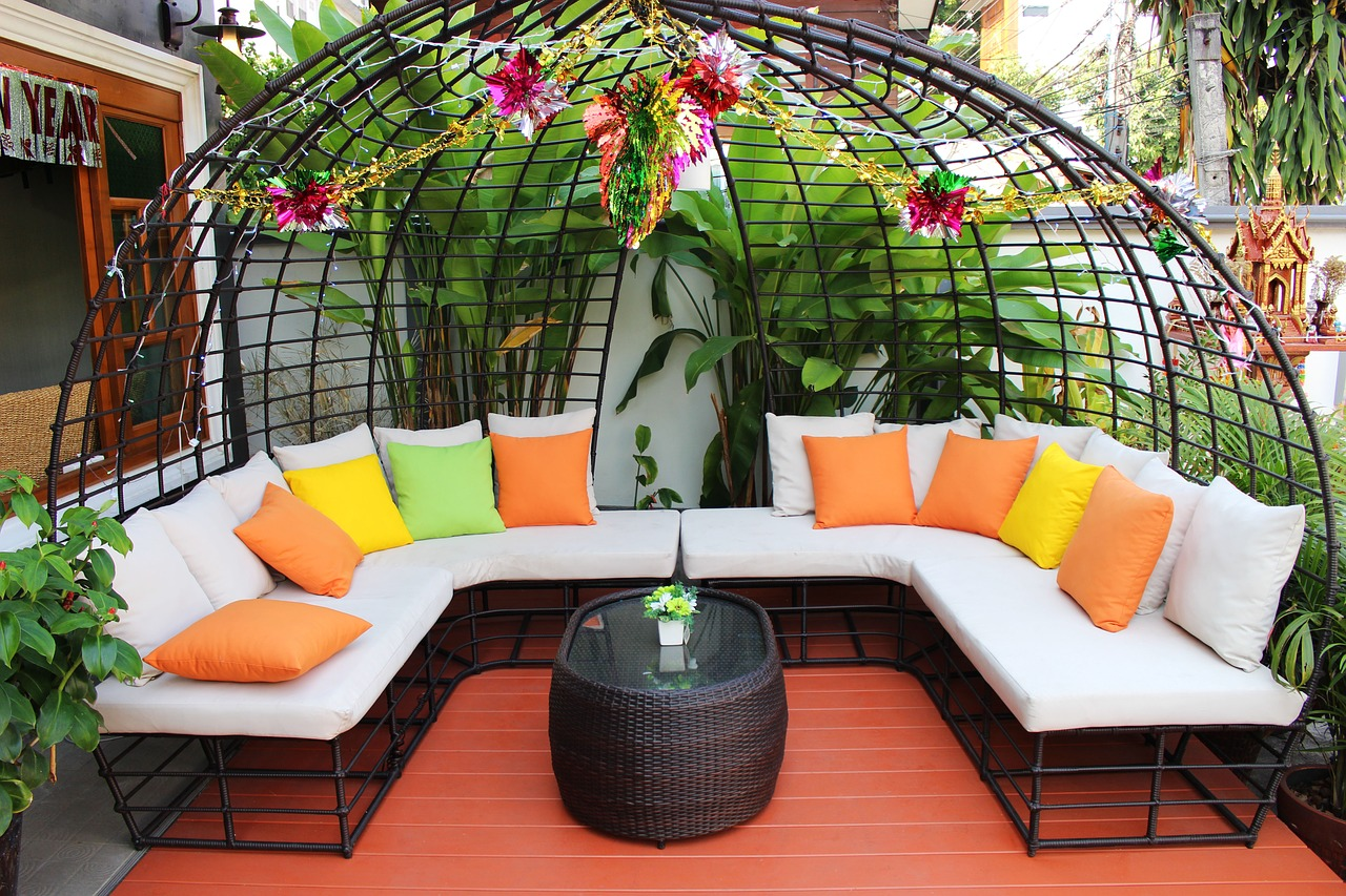 wide shot of luxury patio with big couch and plants